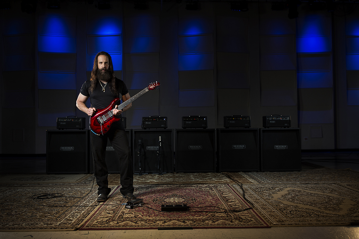 John Petrucci with his signature Ernie Ball Music Man John Petrucci Monarchy Majesty Electric Guitar